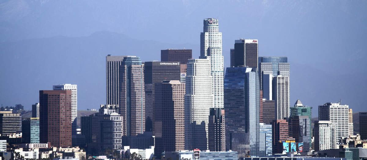 Image of LA skyline, representing the companies that do business in California and how the shifting sands of employment law require a results-oriented, accessible and reliable California employer defense law firm like the Law Offices of Susan A. Rodriguez, APC.