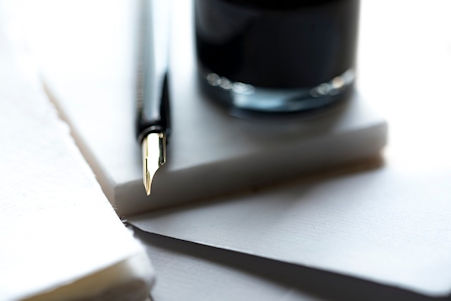 Image of a notebook and fountain pen representing the work a California employer class action defense attorney puts into both class action and PAGA cases.